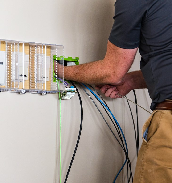 Lifeline expert running cable at a college or univeristy